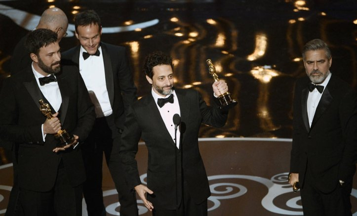 Ben Affleck, Grant Heslov and George Clooney collect the best picture Oscar for Argo